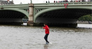 DYNAMO: MAGIC IMPOSSIBLE walks on the water across the River Thames in London.